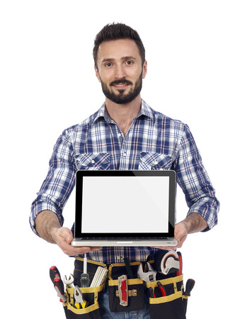 building contractor: Carpenter showing laptop Stock Photo