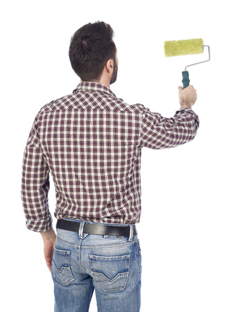 man painting: Man painting with a paint roller Stock Photo