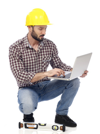home addition: Carpenter working on laptop, white background