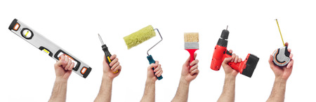 Hands raised holding different tools Imagens