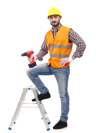 Carpenter with safety vest and drill photo