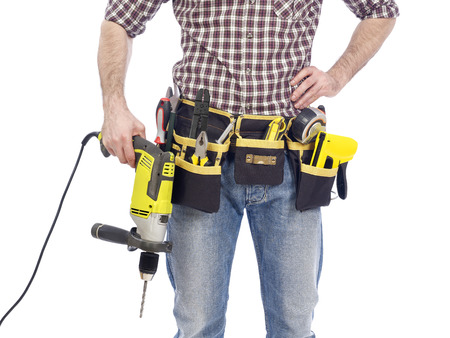 tool  belt: Carpenter with tool belt and drill