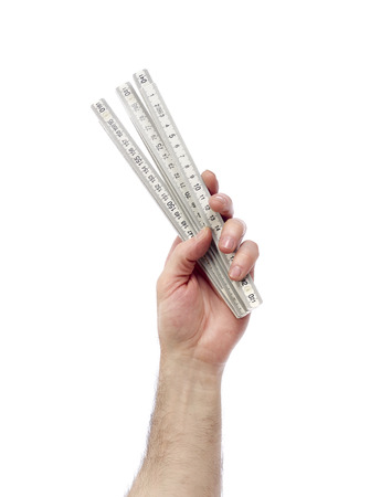 class maintenance: Hand with ruler Stock Photo