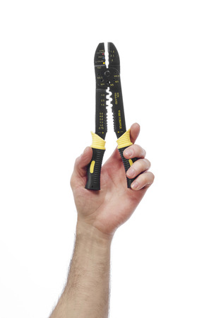 class maintenance: Hand with wire stripper