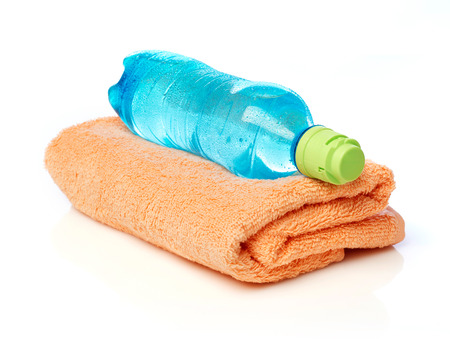water bottle: Water bottle and towel Stock Photo