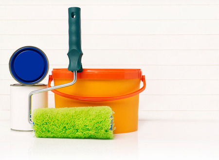 home addition: Paint roller, paint bucket and paint cans