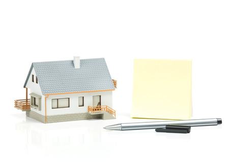 savings problems: House and paper note Stock Photo