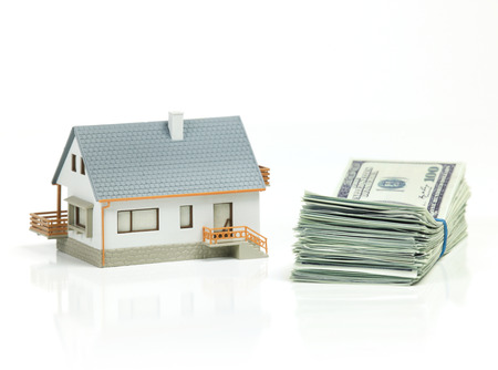 residential building insurance: House and stack of dollars