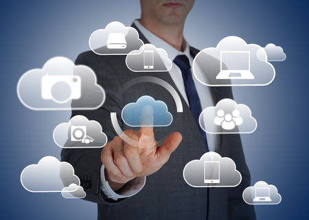 a concept: Business man touching cloud technology Stock Photo