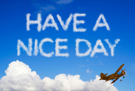 have on: Have a nice day message on the sky Stock Photo