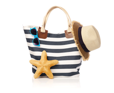 recreational pursuits: Summer bag with sunglasses, starfish and straw hat