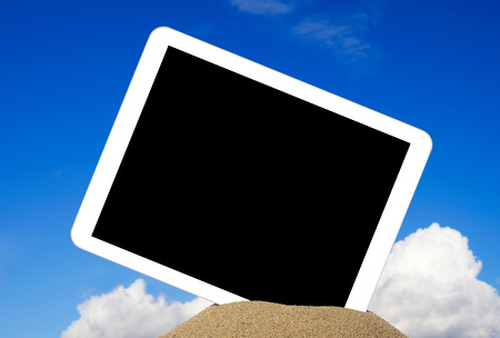 palmtop computer: Tablet in sand Stock Photo