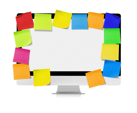 crowded space: Computer with adhesive notes