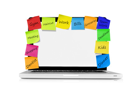 crowded space: Laptop with resolution adhesive notes