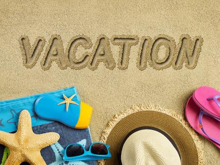 Vacation text on sand photo