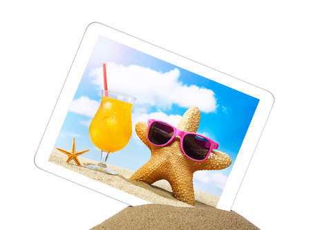 palmtop: Tablet in sand Stock Photo