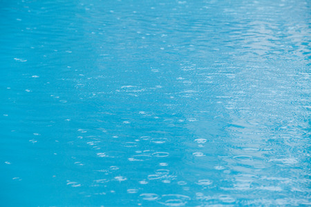 no swimming: Rain on water