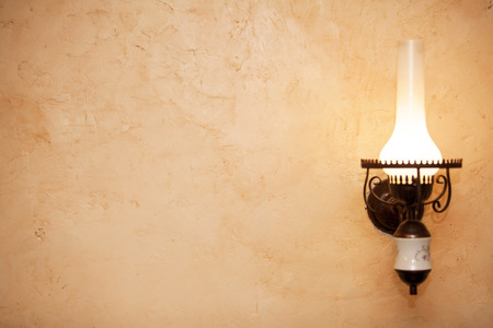 yellow lamp: Old lamp on wall