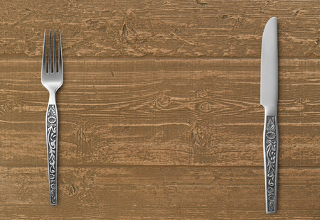 table knife: Table knife and fork on wood