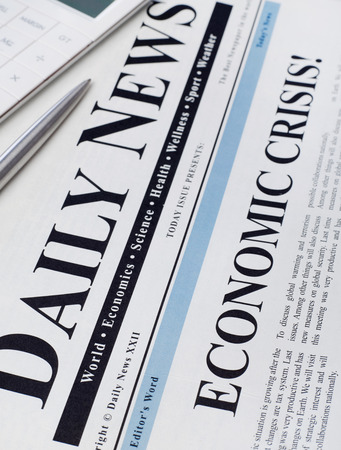 crisis: Economic crisis headline on newspaper