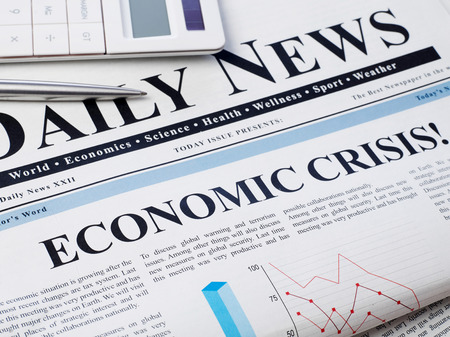 Economic crisis headline on newspaper