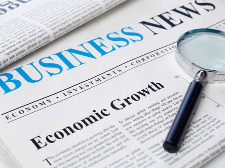 changing form: Economic growth headline on newspaper