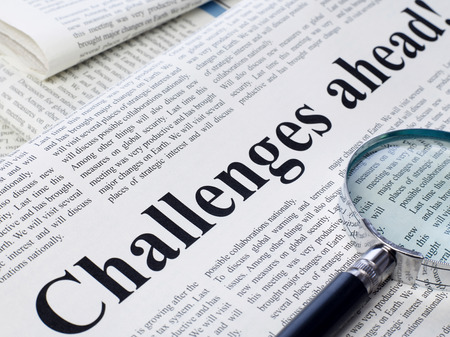 single word: Challenges ahead headline on newspaper Stock Photo