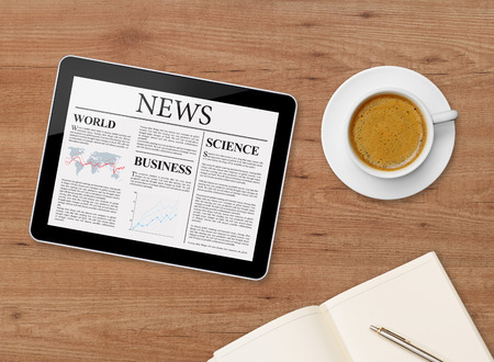 articles: News page on tablet and coffee cup