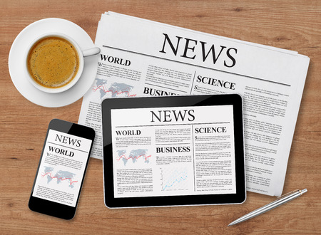 media equipment: News page on tablet, mobile phone and newspaper