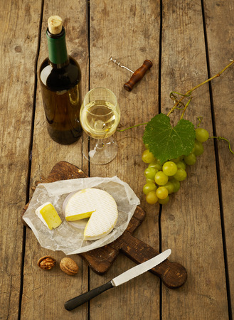 winetasting: White wine, grapes and cheese