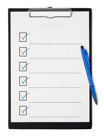 Checklist on clipboard Фото со стока