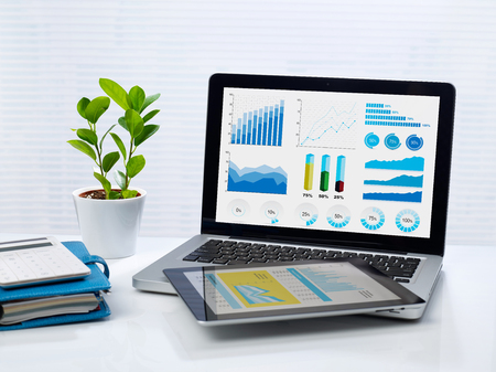 Laptop, tablet and office supplies on desk Stock Photo