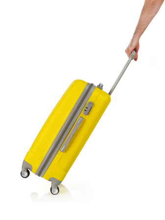 carrying: Carrying a suitcase Stock Photo