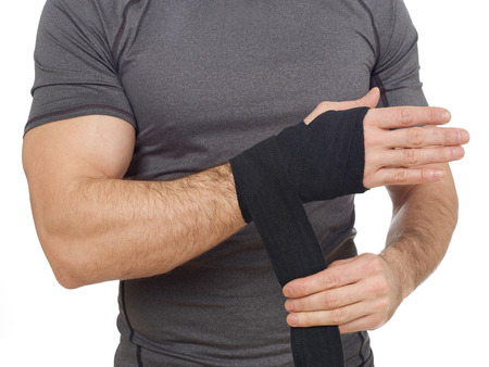 Man wrapping his wrist