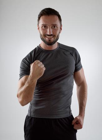sportsmen: Happy sportsman looking at camera