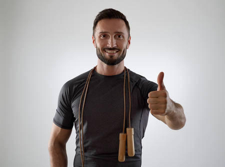 jump rope: Trainer with jump rope showing ok sign Stock Photo