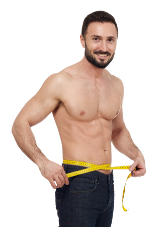 beauty body: Muscular man with tape measure around his waist