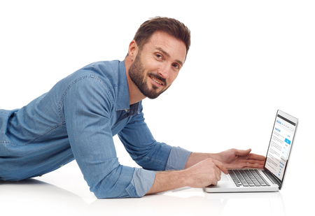 man looking down: Man with laptop