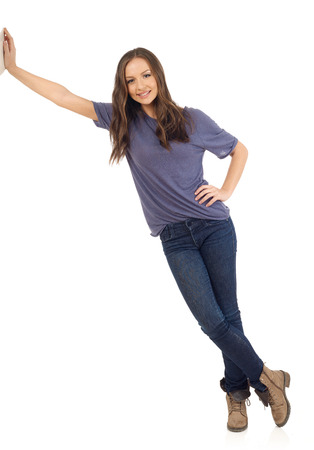 woman relaxing: Smiling girl lean on wall