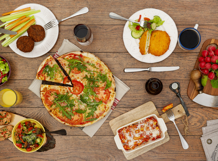 plates of food: View from above the table of dishes