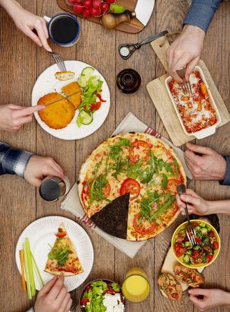 eating dinner: Family eating