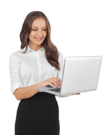 working woman: Woman working on laptop Stock Photo