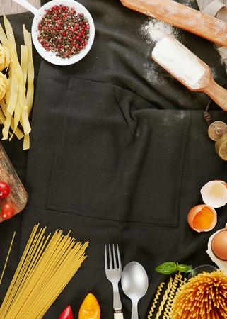 kitchen apron: Kitchen apron, ingredients and pasta Stock Photo