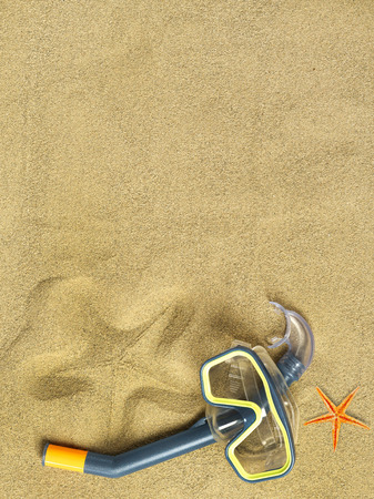 swimming goggles: Starfishes and swimming goggles on sand Stock Photo