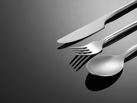 silver reflection: Fork, spoon and knife Stock Photo