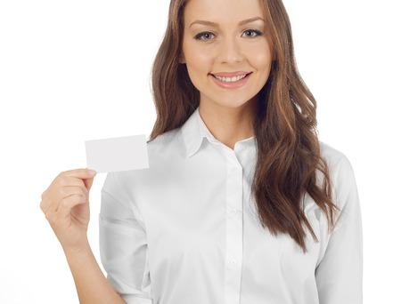 Frau hält eine Visitenkarte Standard-Bild