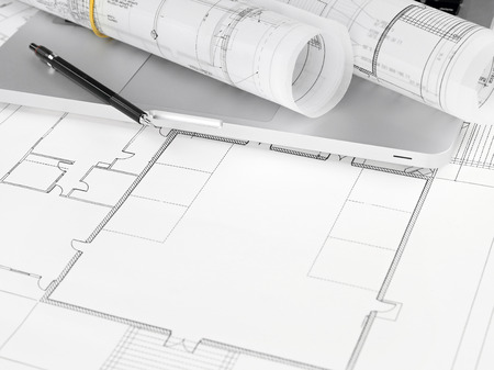 home addition: Blueprints and laptop Stock Photo