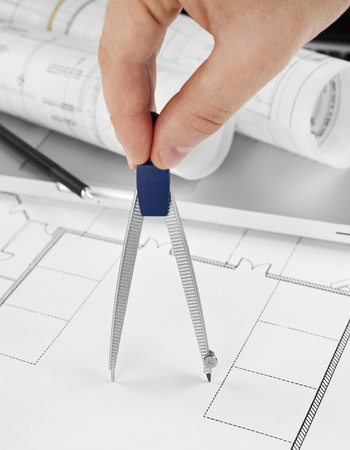 showcase interiors: Architect with drawing compass Stock Photo