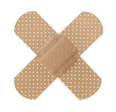 adhesive bandage: Cross adhesive bandage Stock Photo