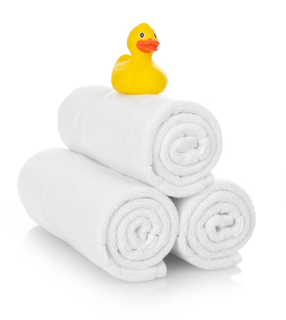 white towels: Rubber duck on white towels Stock Photo